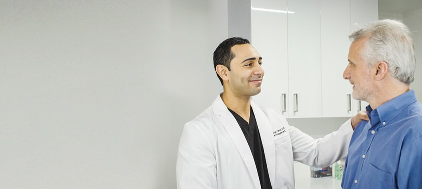 Dr. Hanna greeting a patient